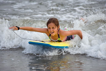 girl in the surf on a boogie board